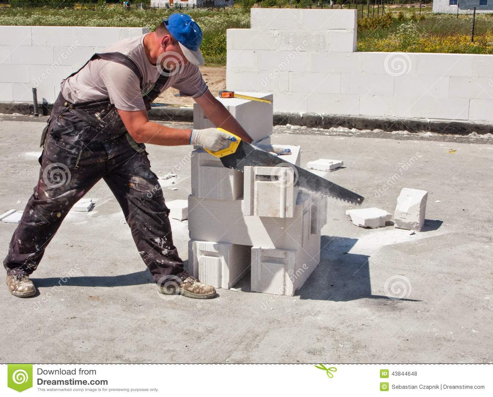 Cutting A Concrete Block Wall : Worker cutting concrete blocks stock photo image