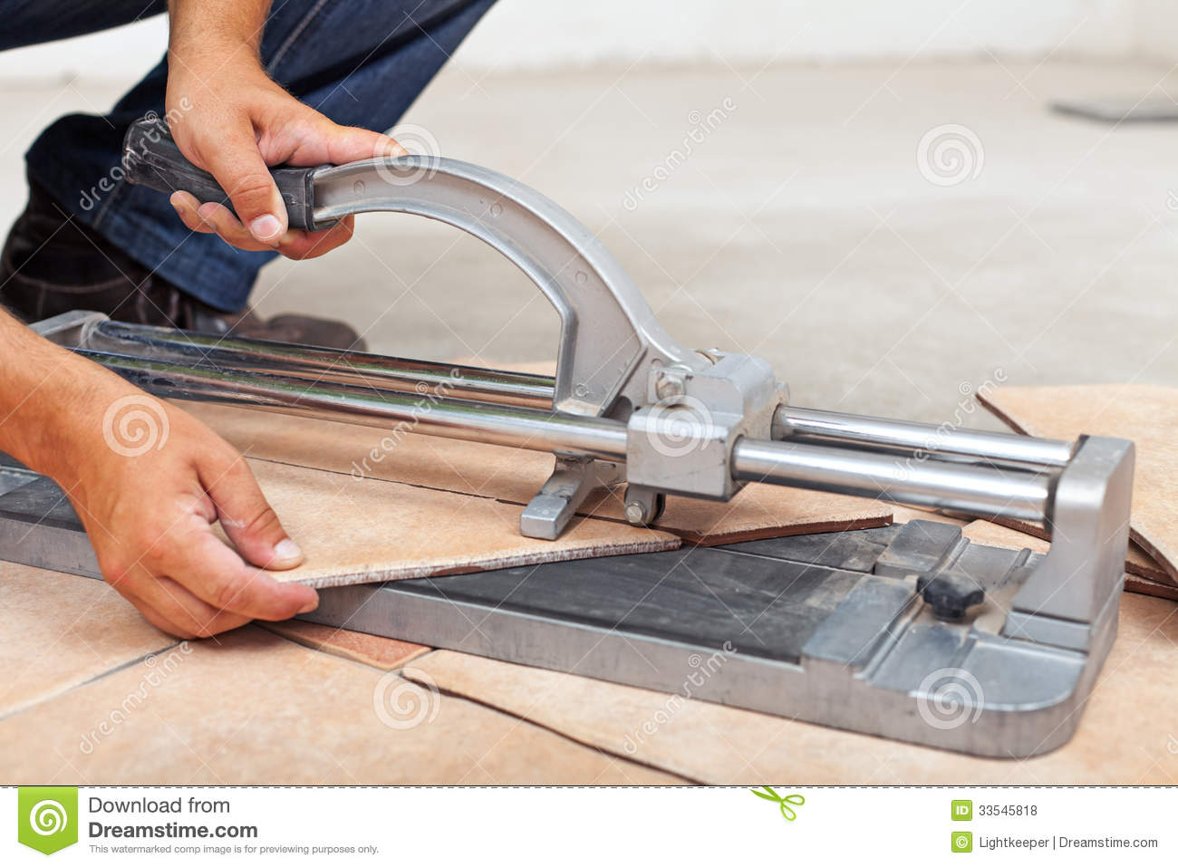 Worker cutting floor tiles with manual cutter stock photo image worker cutting floor tiles with manual cutter dailygadgetfo Images