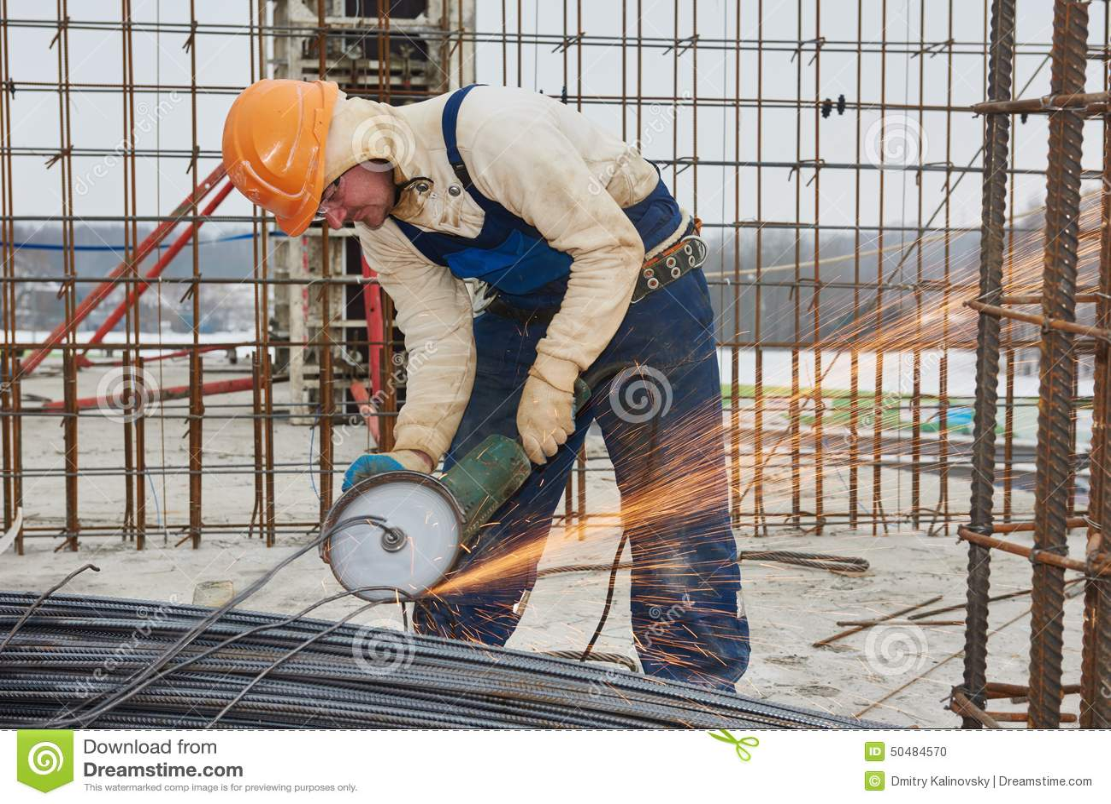 worker cutting rebar by grinding machine