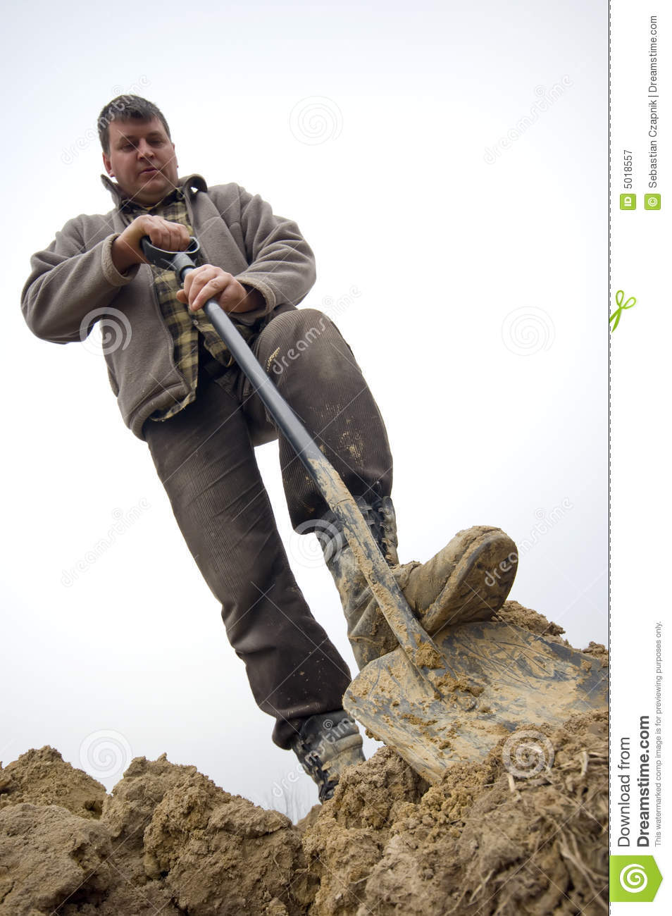 Worker digging in the ground royalty free stock for Digging ground dream meaning