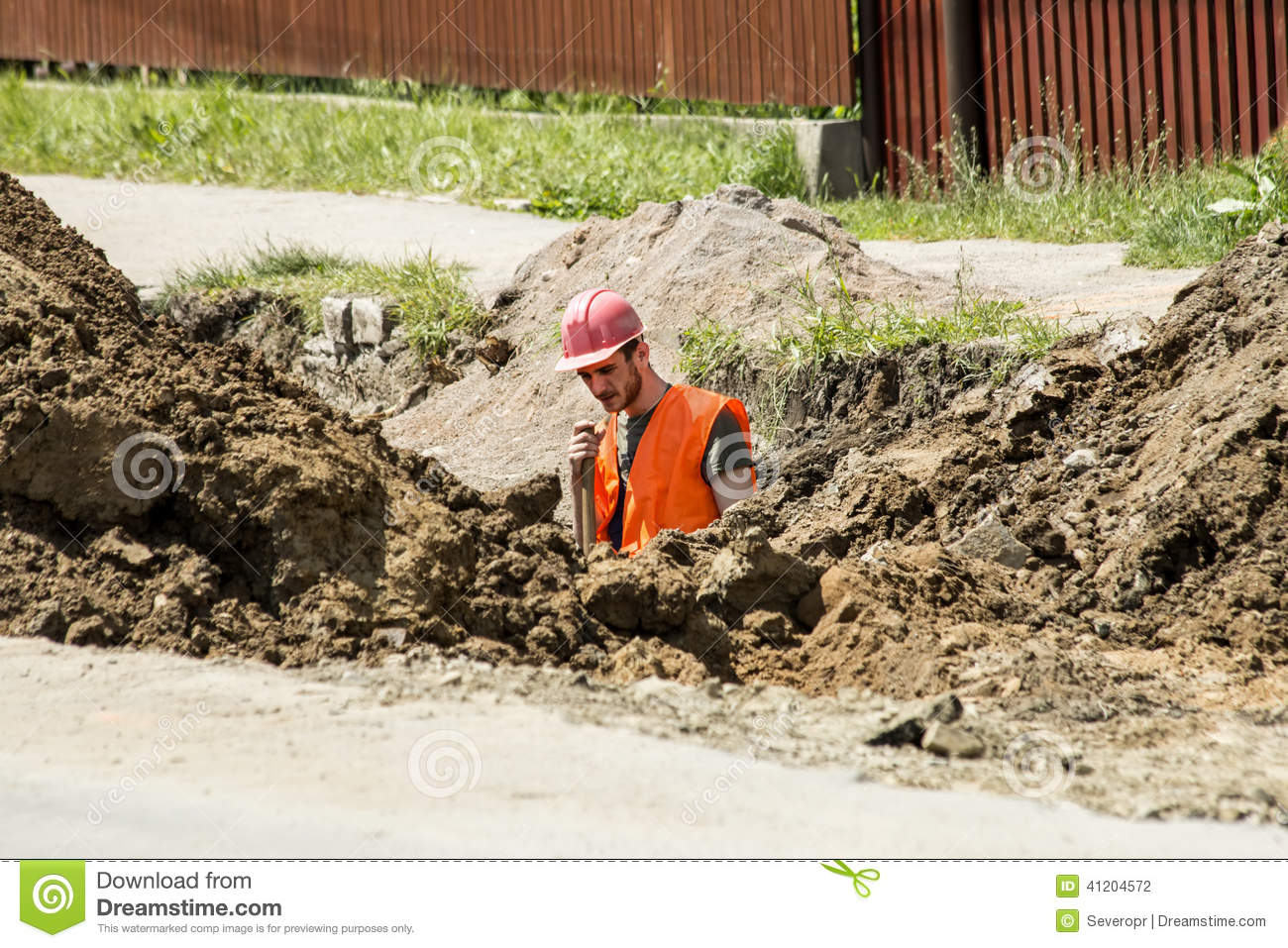 Worker digging a trench for sewer
