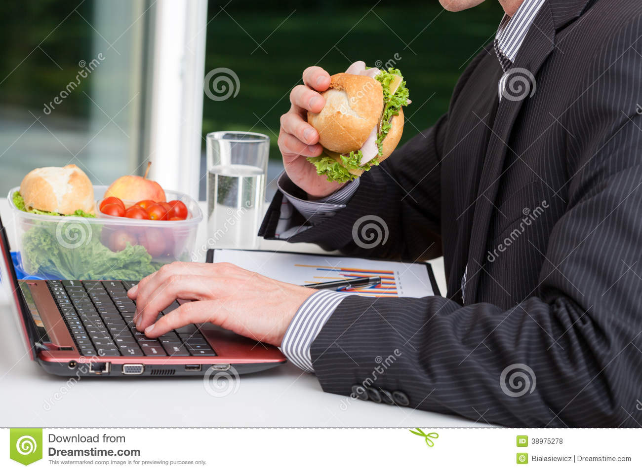 worker eating popcorn at cinema concession stand stock photo worker eating at his desk royalty stock photos