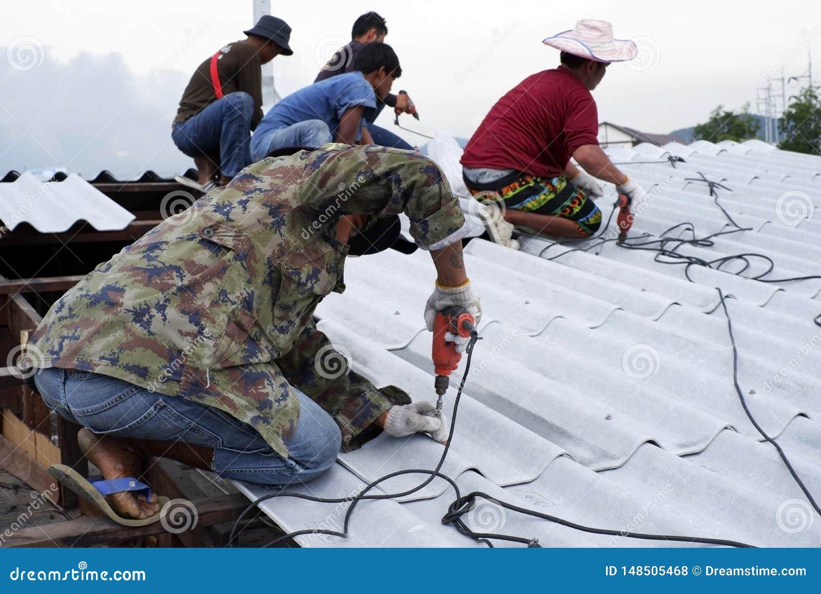 Worker fixing roof top