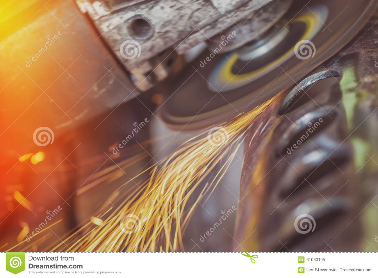 Worker grinding steel pipe with grinder stock image