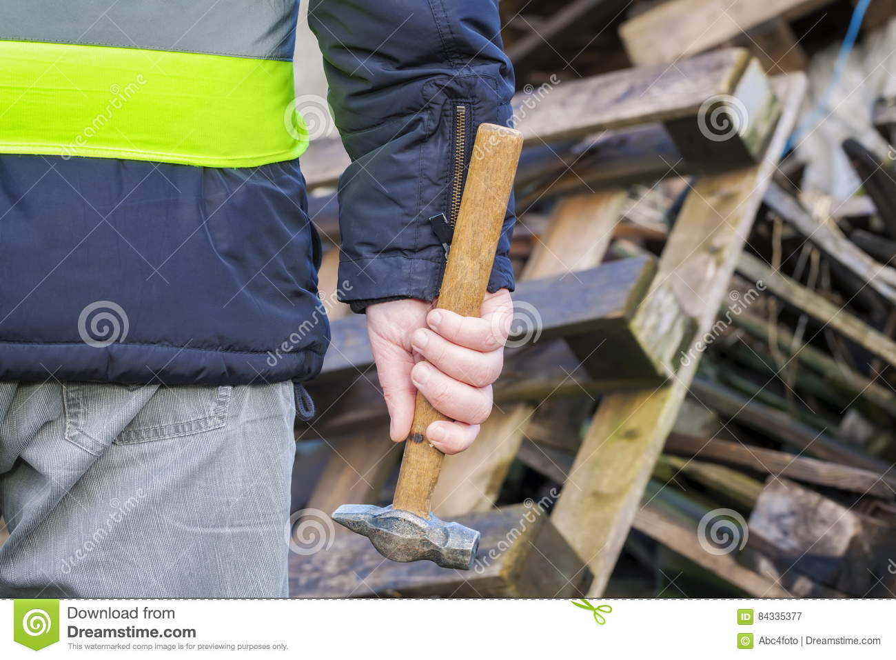 Worker With Hammer Near Wooden Pallets Stock Image - Image ...