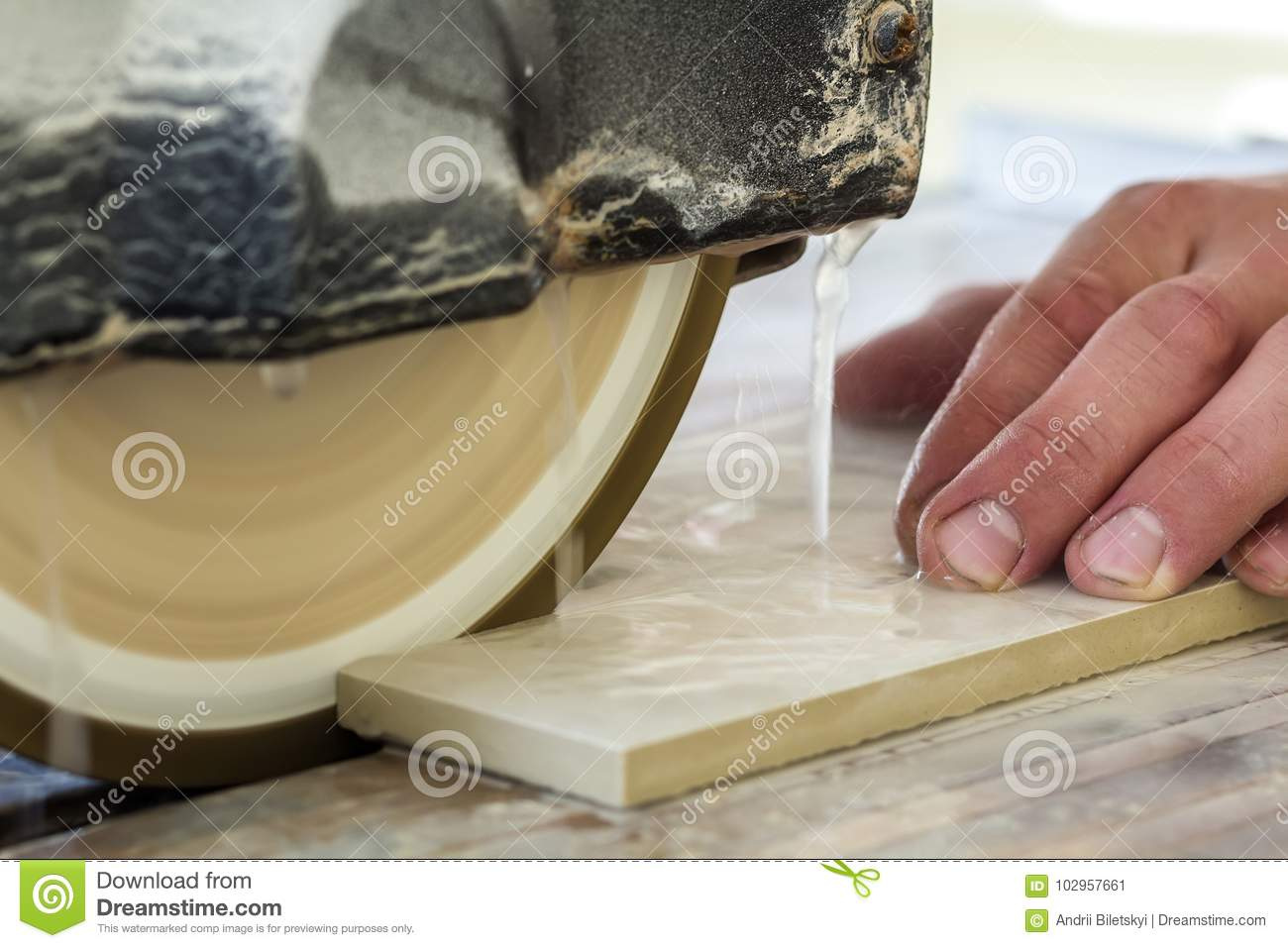 Worker Hand Cutting Ceramic Tile With Water Cutting Machine Clos - Ceramic tile cutting boards
