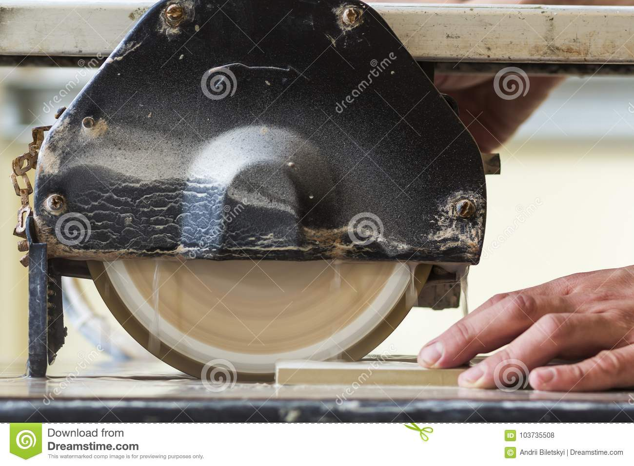 Worker Hand Cutting Ceramic Tile With Water Cutting Machine Clos