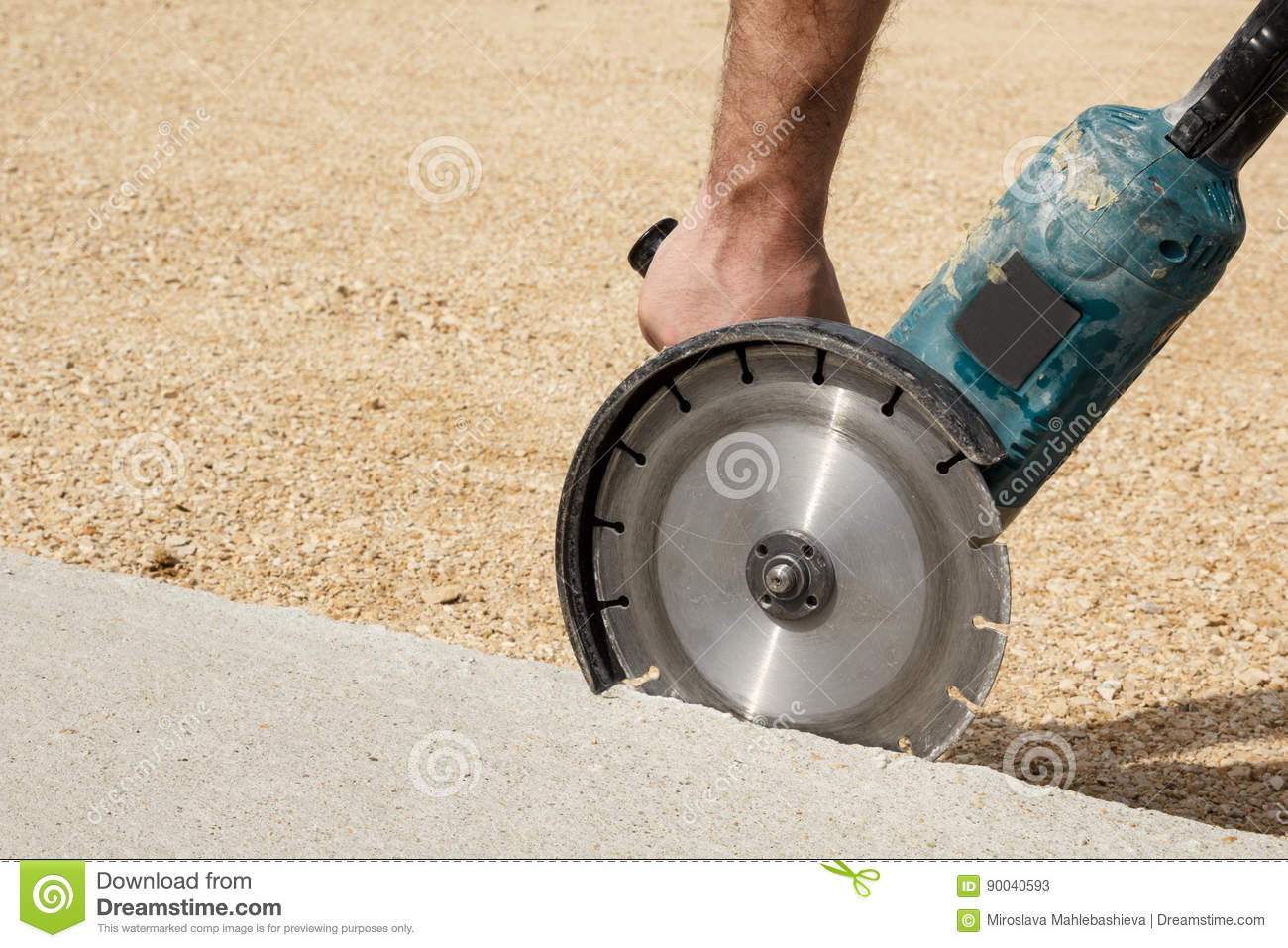 Worker Hand Holding Angle Grinder With Diamond Concrete