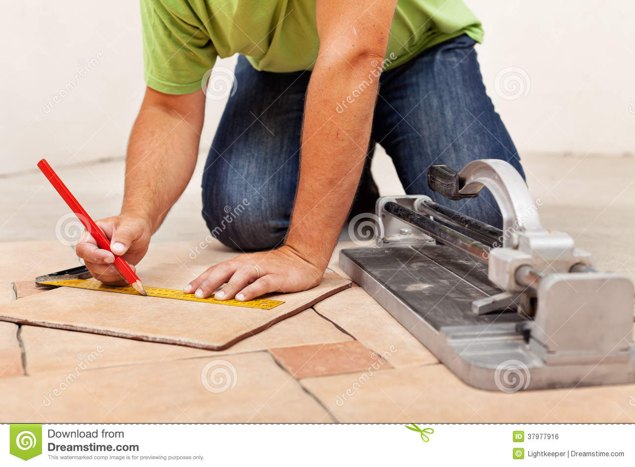 Worker hands laying ceramic floor tiles stock photo image of worker hands laying ceramic floor tiles dailygadgetfo Image collections