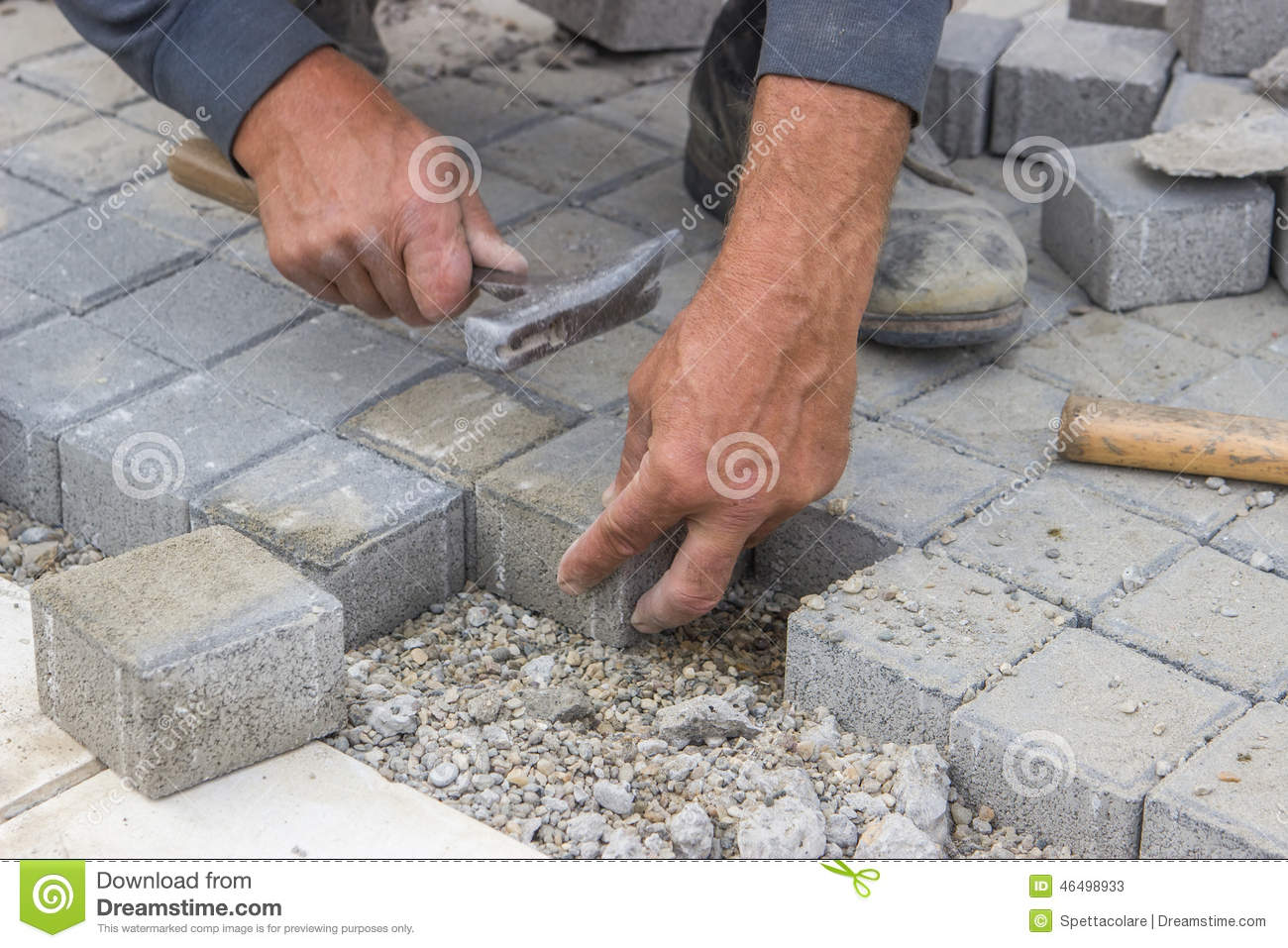 Worker Hands Laying Concrete Brick Pavers Stock Photo
