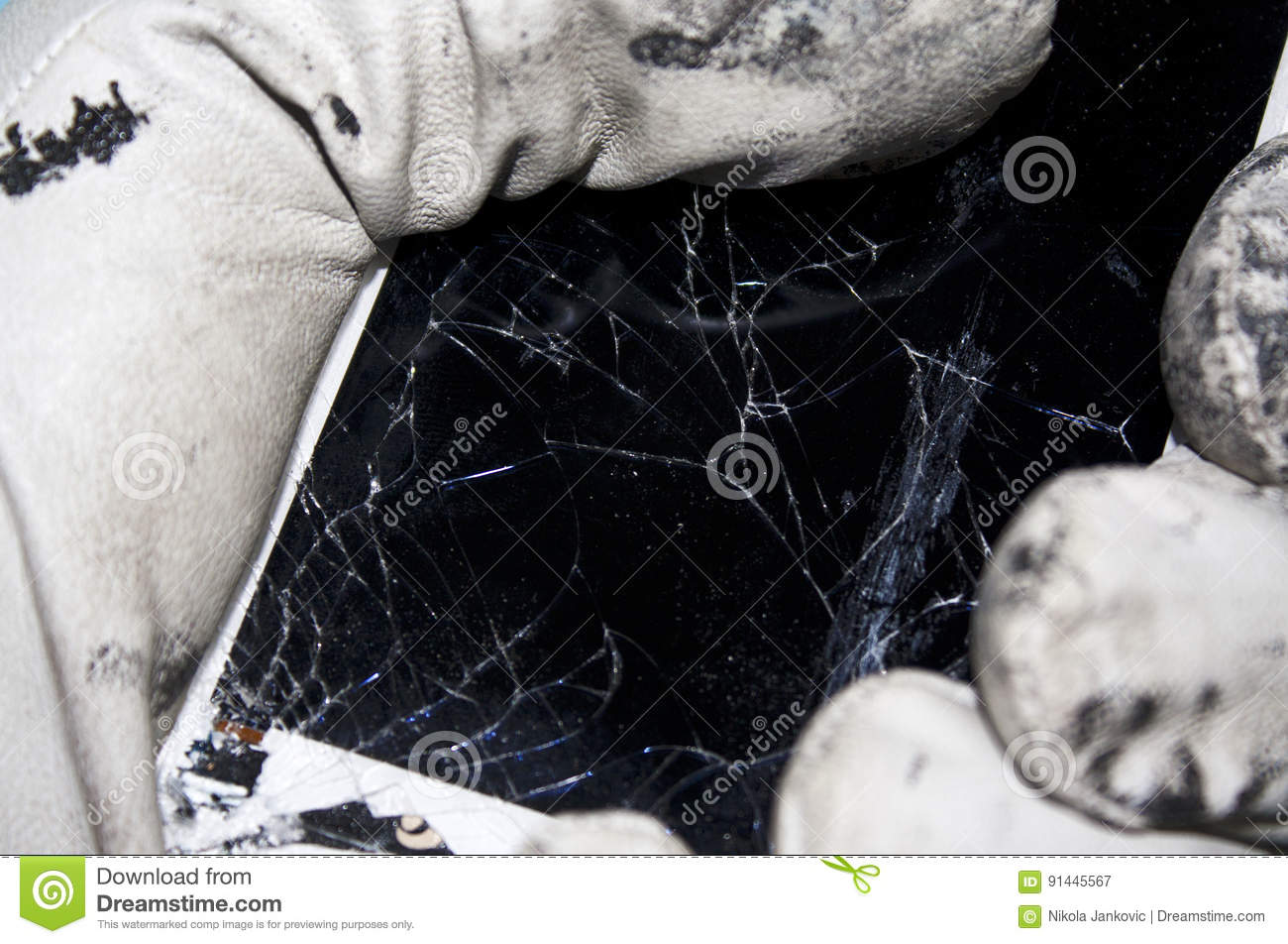 Worker holding broken mobile phone