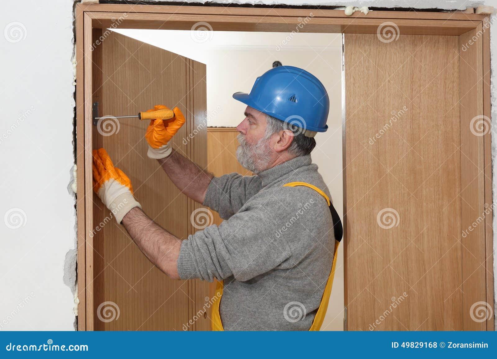 Royalty Free Stock Photo. Download Worker Install New Door ...