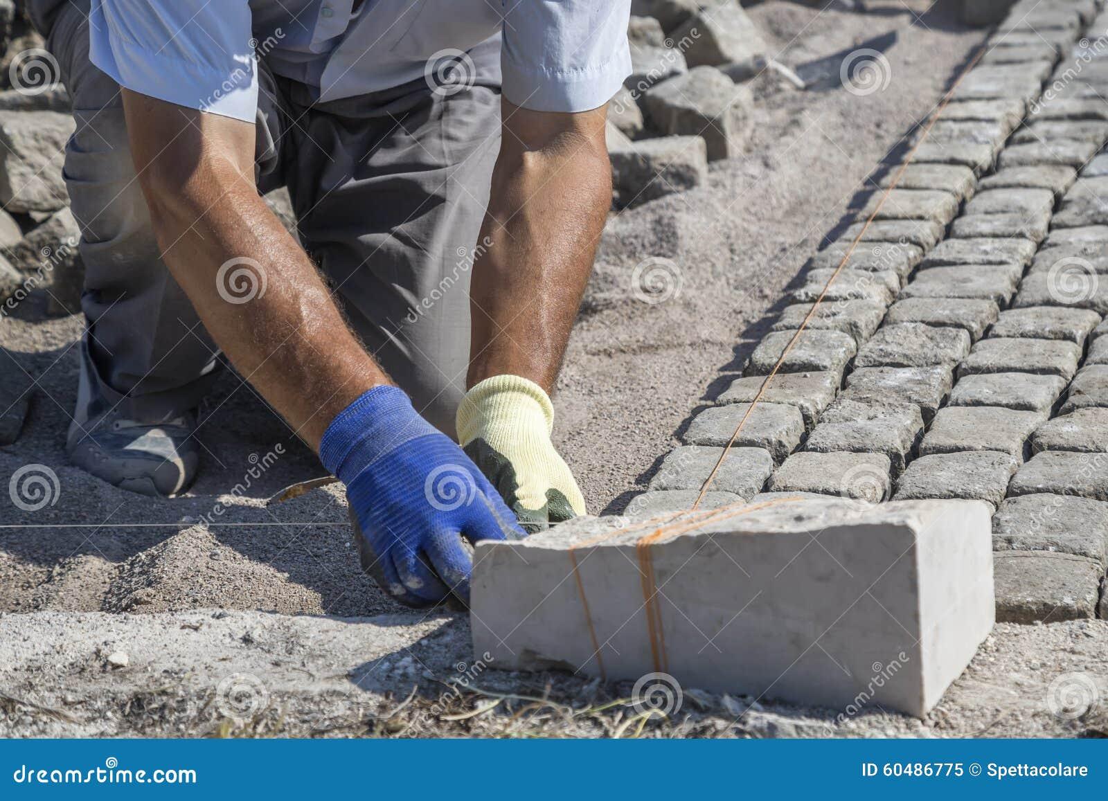 Worker Installing Granite Cubes 2 Stock Image - Image of