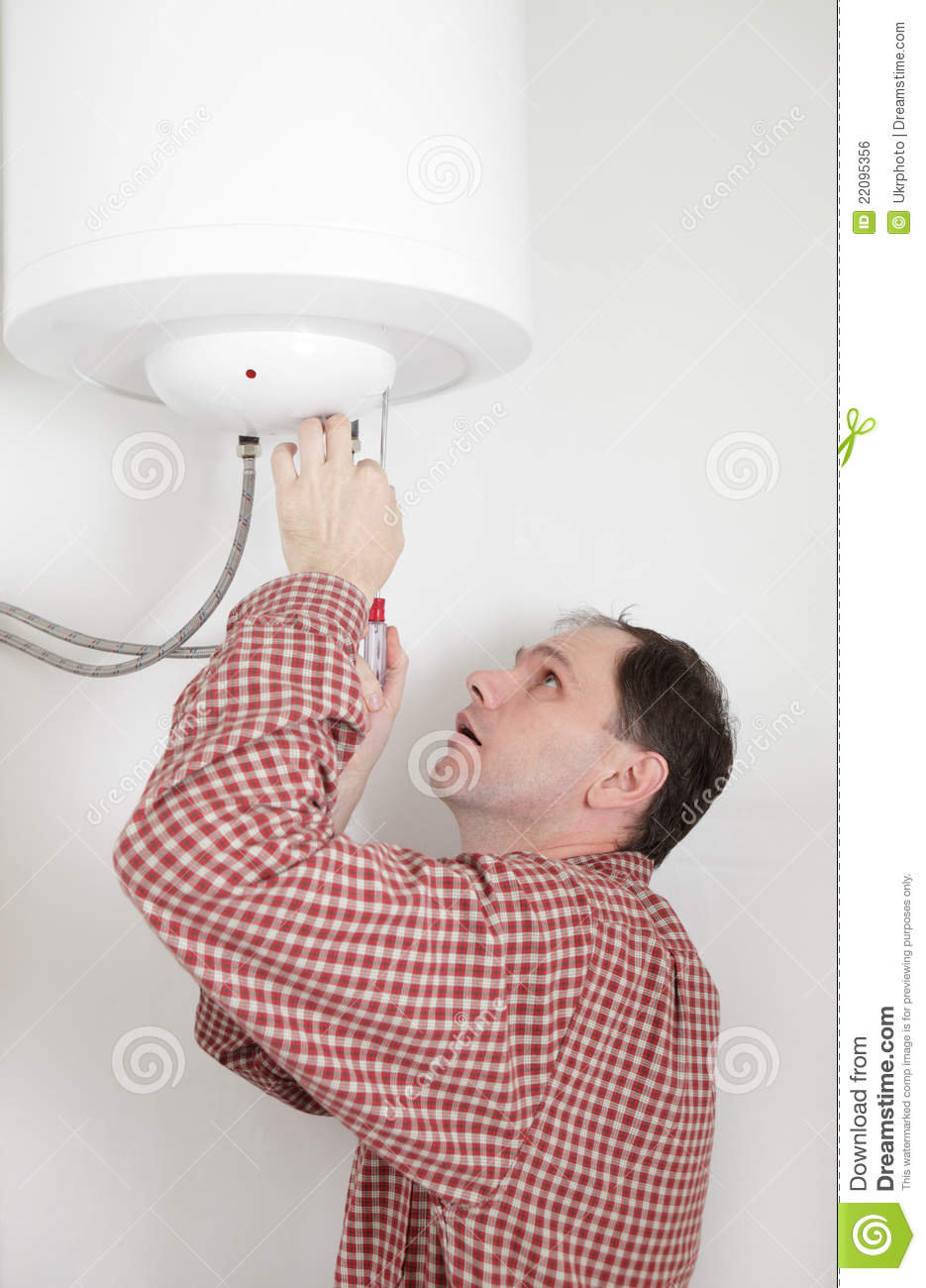 Worker Installing A Water Heater Stock Photo Image Of Repairman How To Wire