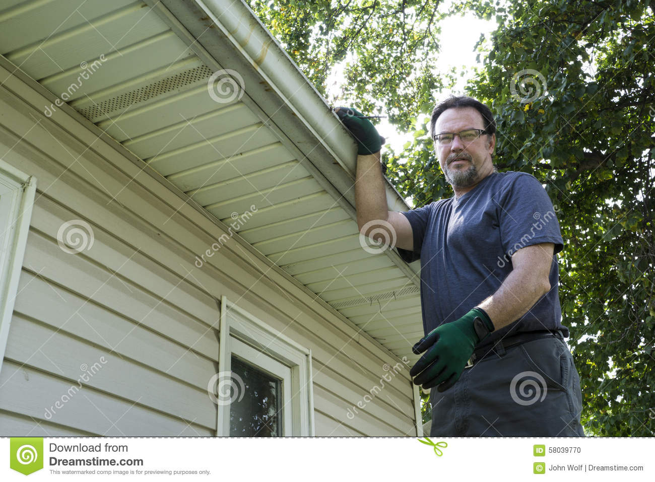 how to clean gutters without getting on a ladder