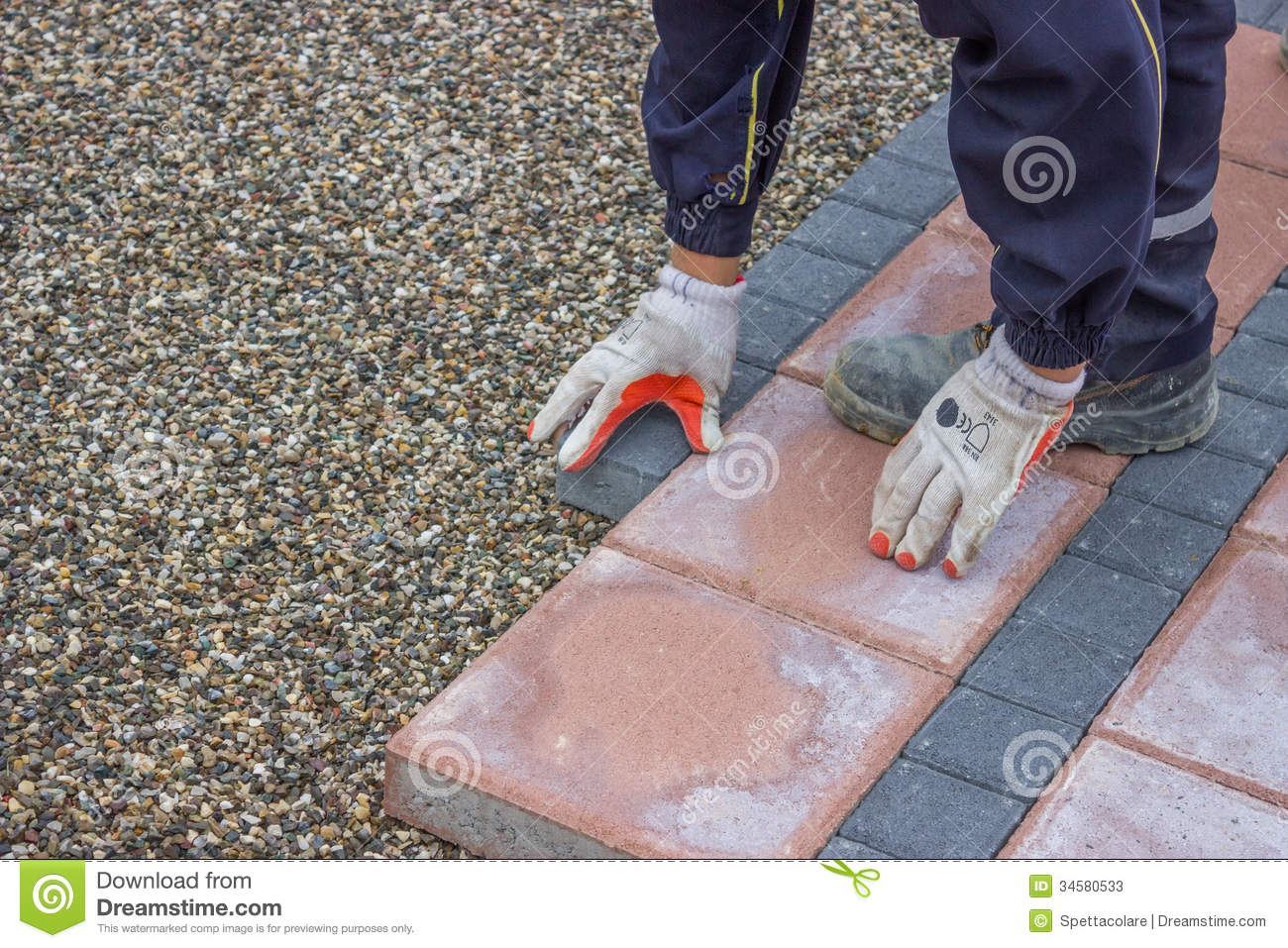 Worker Lays Brick Pavers Along The Sidewalk Stock Image