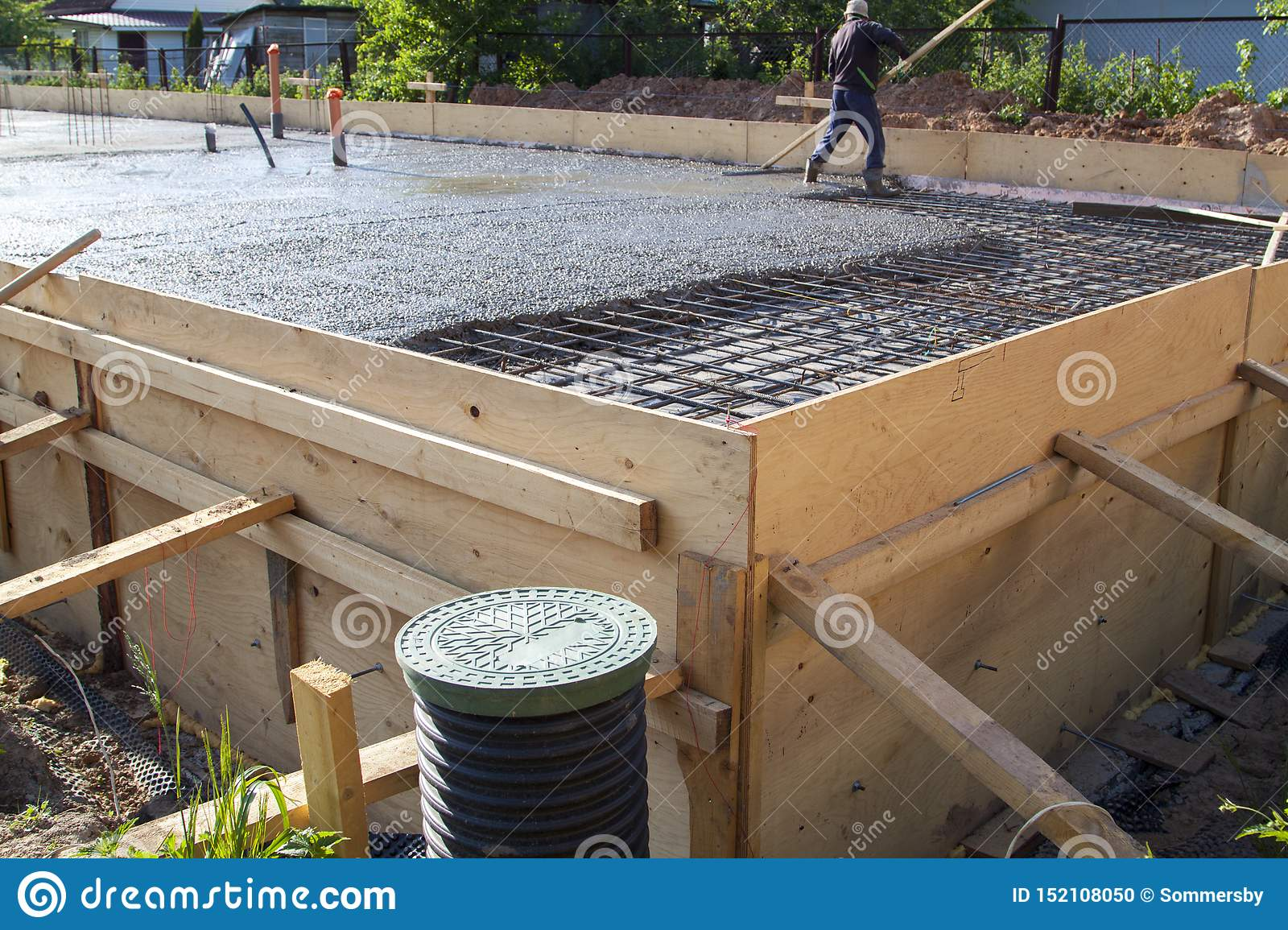 Worker Leveling Fresh Concrete Slab With A Special Wooden Workin Stock Photo Image Of Development Occupation 152108050