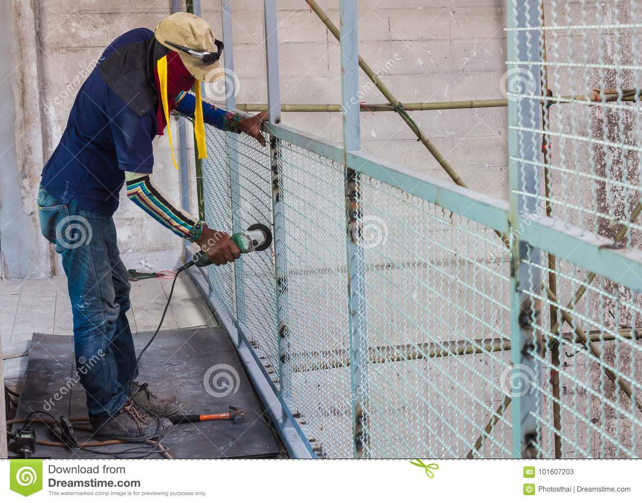 Worker Man With Electric Wheel Grinding Stock Image - Image