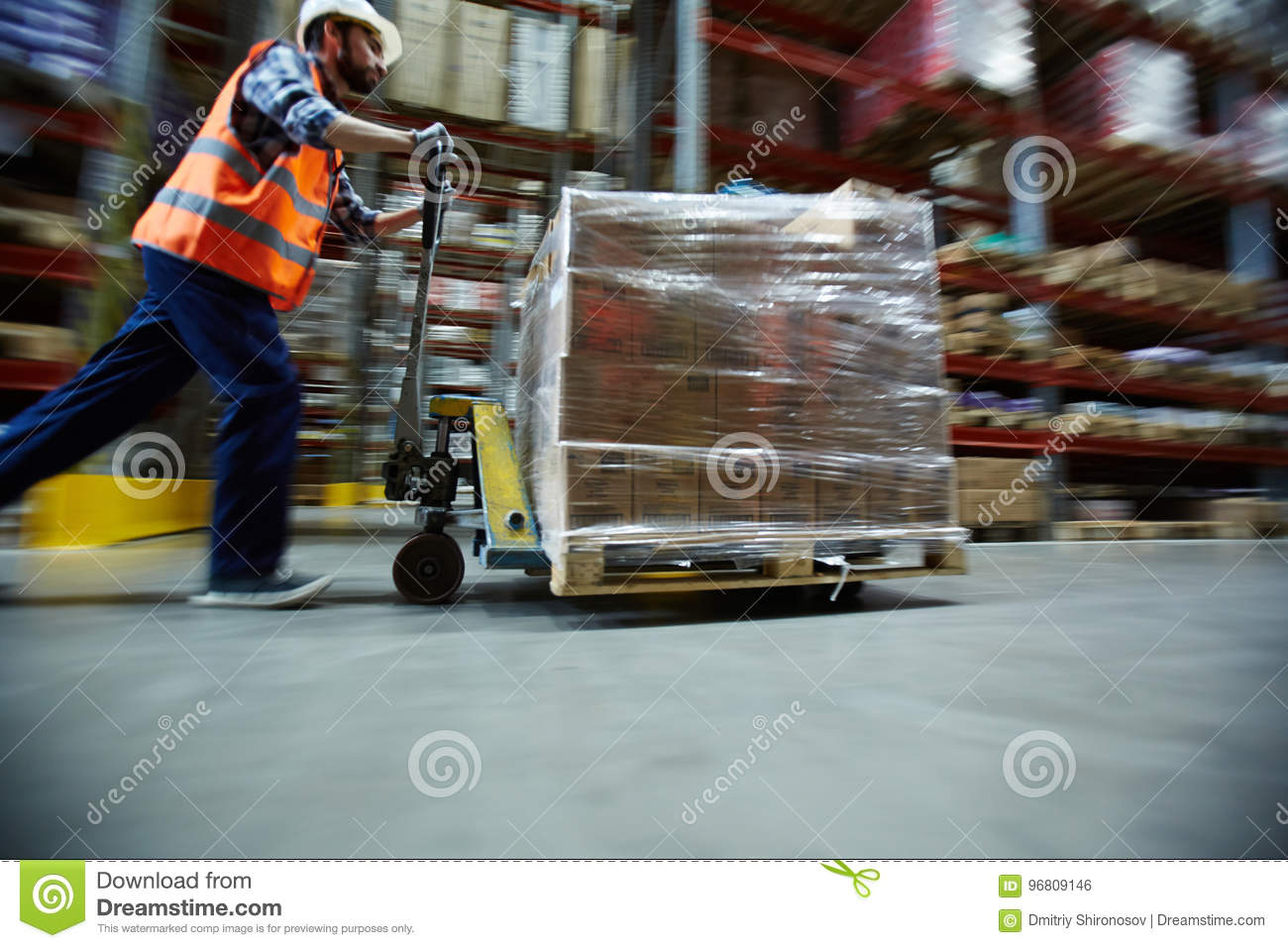 Worker Moving Retail Merchandise in Large warehouse