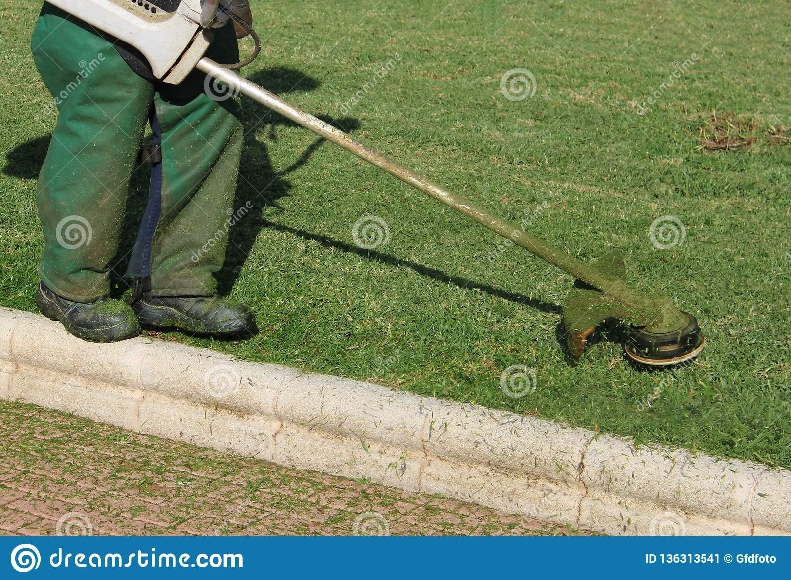 Worker mowing the lawns