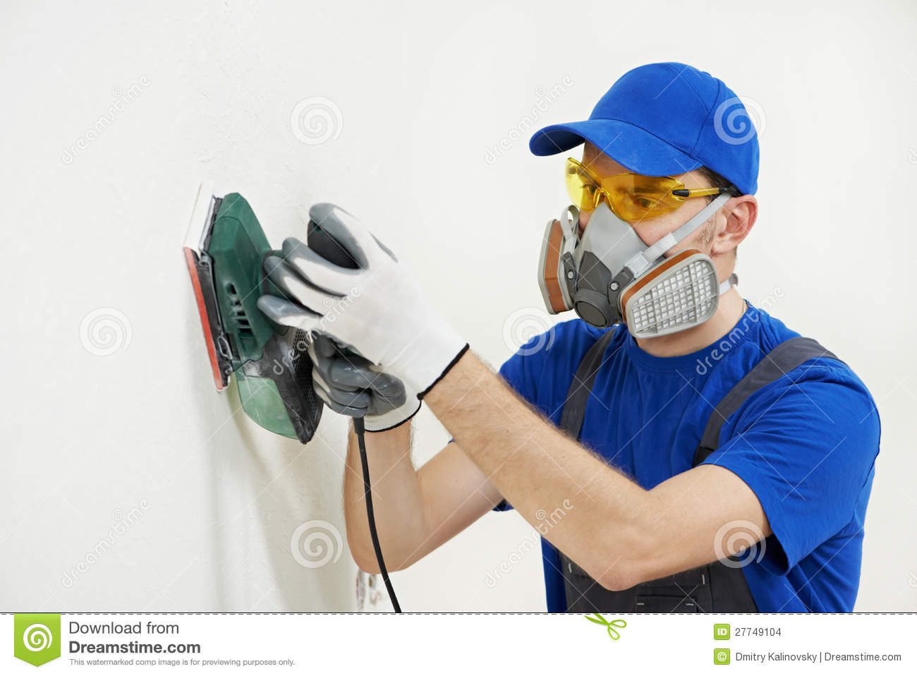 Worker With Orbital Sander At Wall Filling Stock Images
