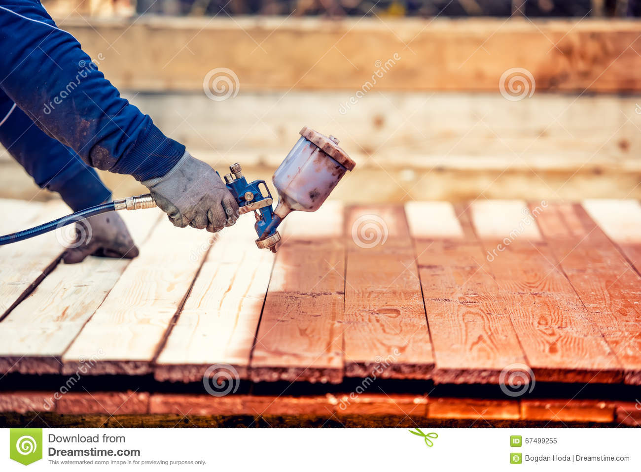 Worker Painting Brown Timber Renovating Exterior Wooden Fence Worker Using Spray Gun Stock