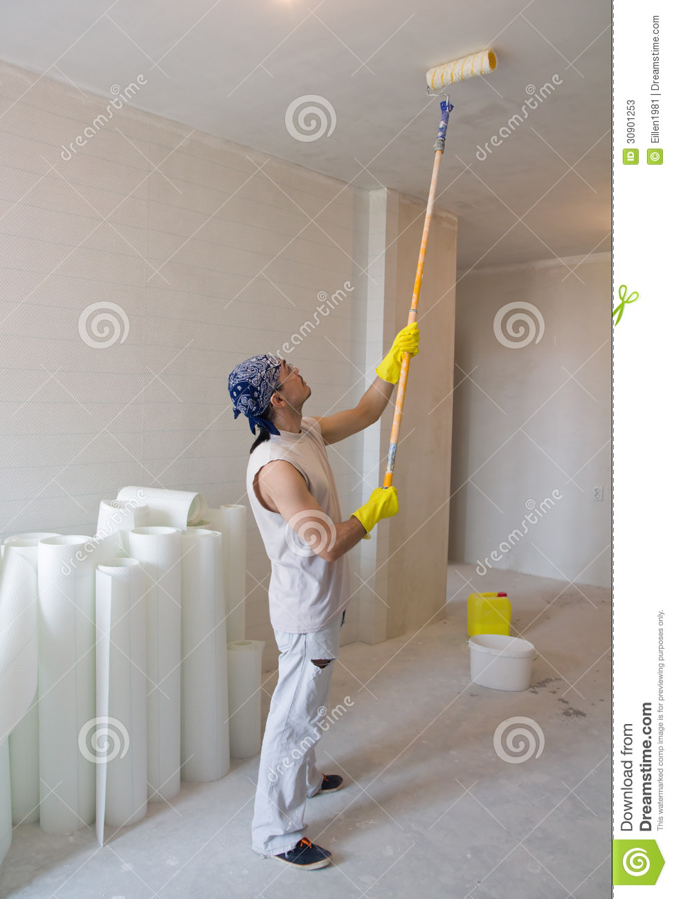 Worker painting ceiling with painting roller stock image - Best roller for exterior painting ...