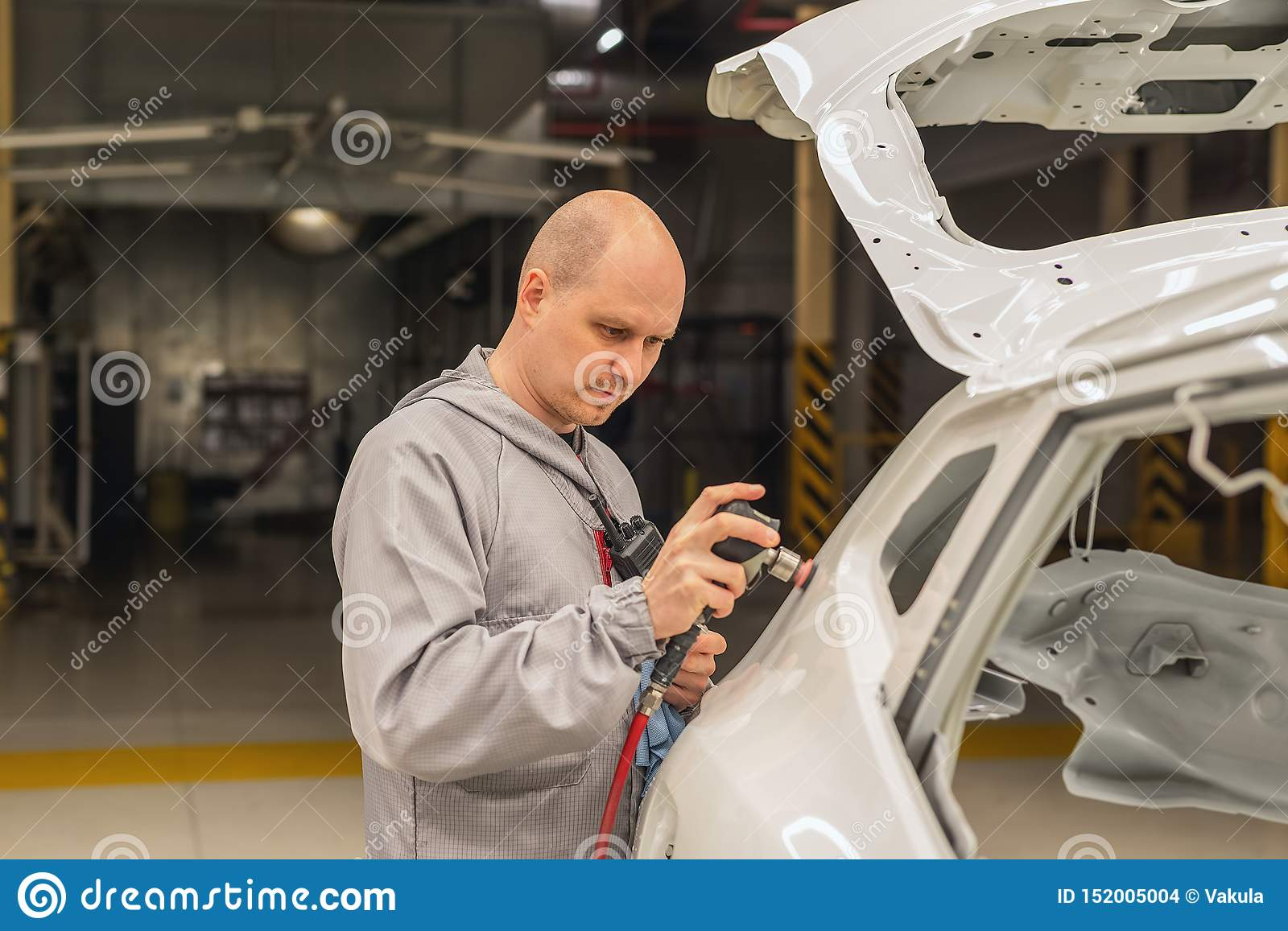 A Worker In The Painting Shop Of A Car Body Sanding Painted Items Stock Photo Image Of Artist Master 152005004