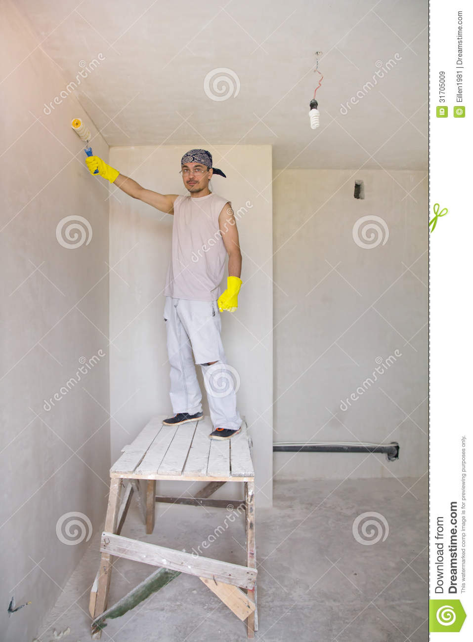 Worker painting wall with painting rollerWorker Painting Wall