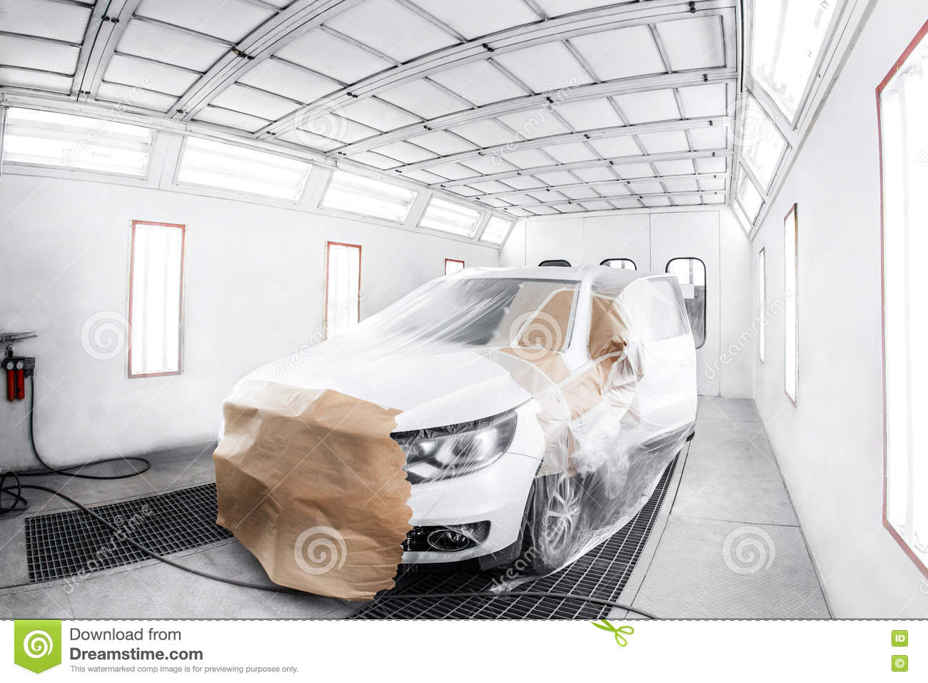 Worker Painting A White Car In Special Garage, Wearing Costume And ...