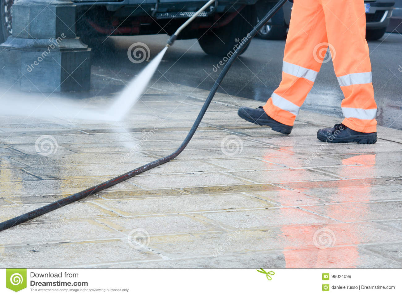 a worker with a pressure washer