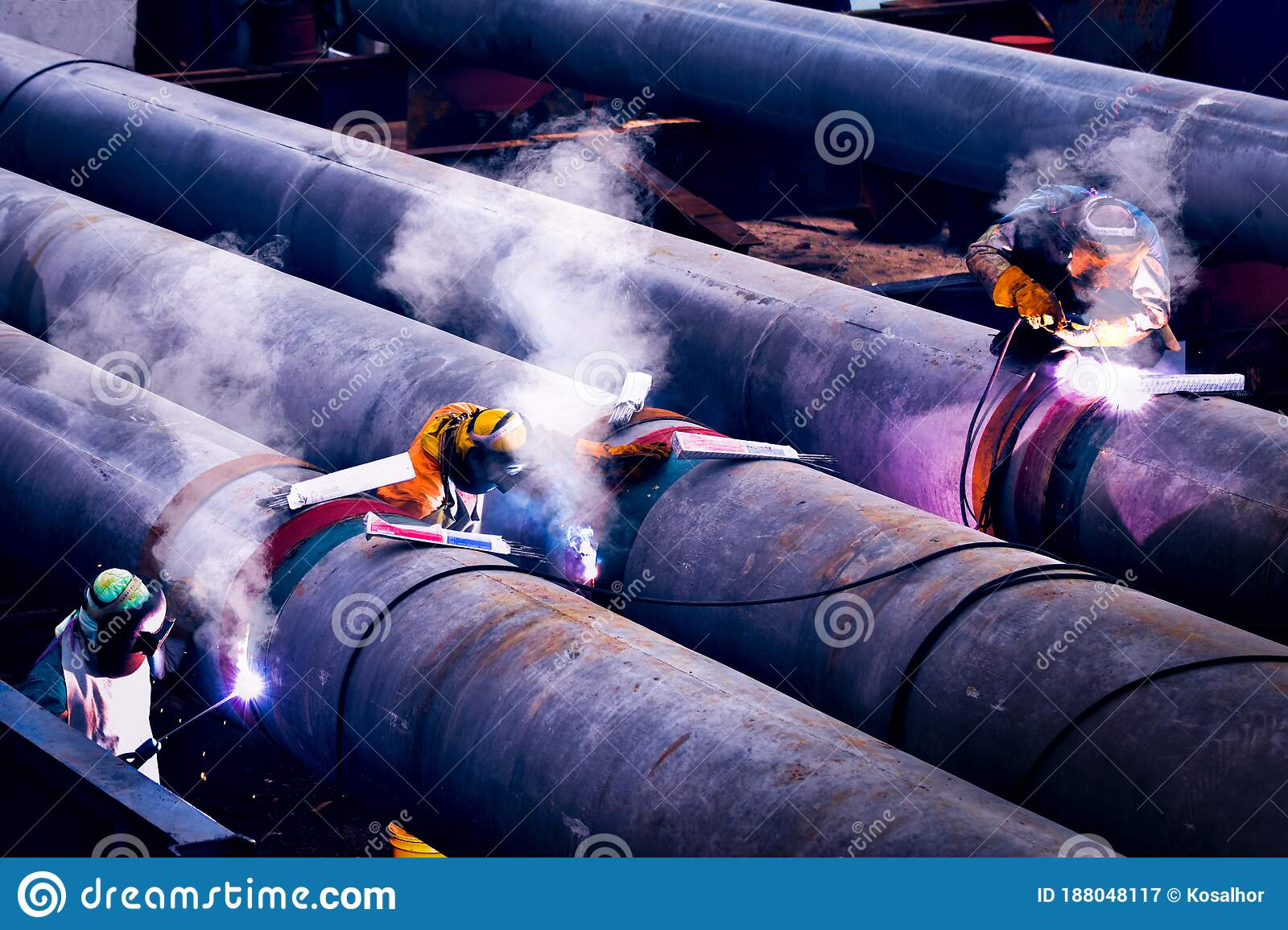 Worker With Protective Mask And Gloves Welding Big Piles At A Construction Site Hard Working Heavy Work Stock Image Image Of Laborer Improvisation 188048117