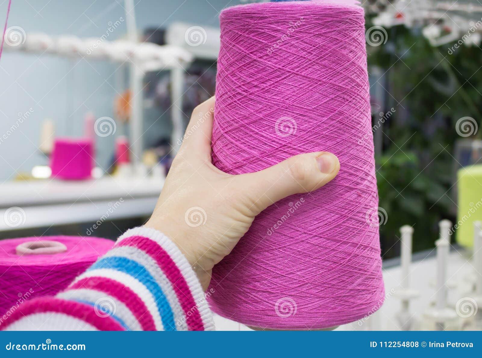worker puts thread knitting machine worker installs threads knitting machine further work 112254808
