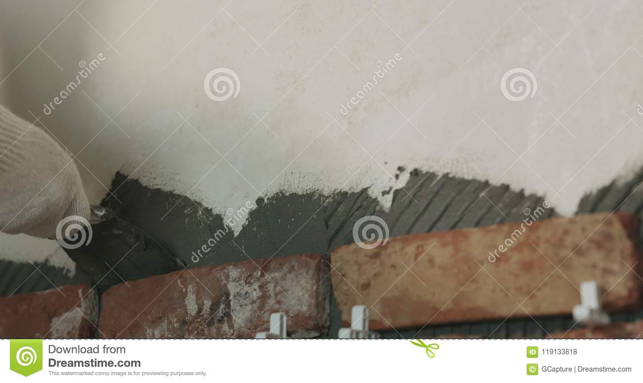 Worker Remove Excessive Concrete Glue To Wall Before