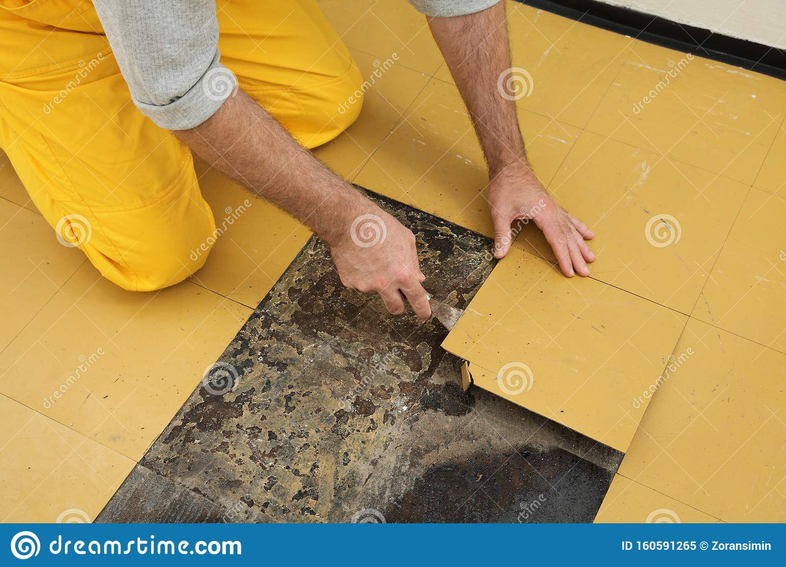 Old Vinyl Tiles Removal From Floor In A Room Or Kitchen Stock
