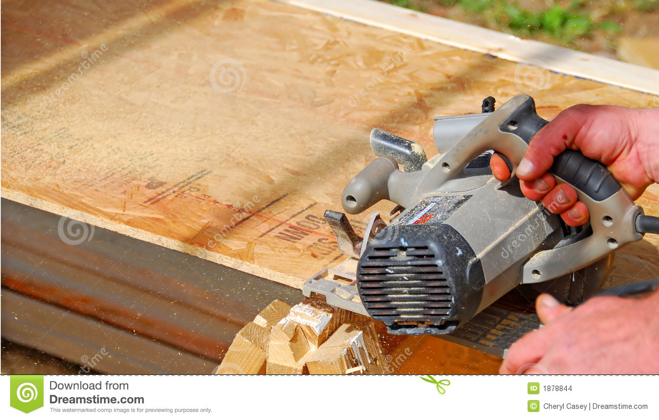 Worker Sawing Wood