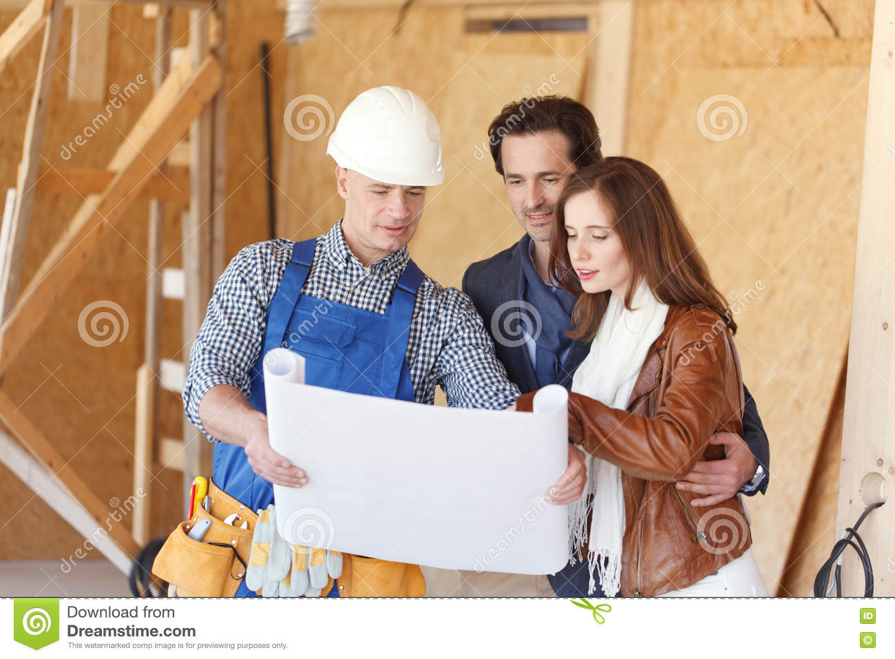 Worker shows house design plans stock photo image of architect uniform 76082444 - House plans for young couples energetic designs ...