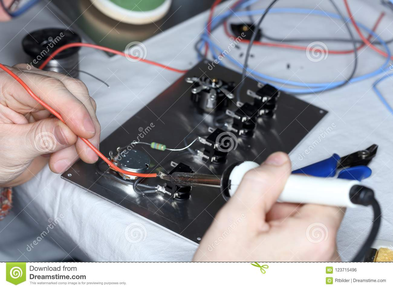 Worker Is Soldering A Red Wire Stock Photo - Image of ... on