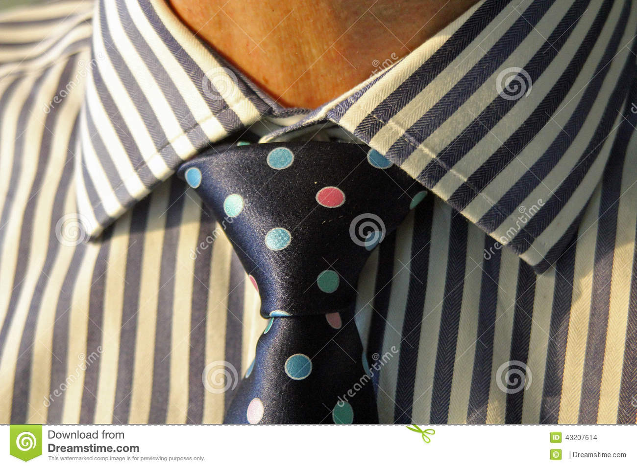 Worker with striped tie and spotty tie