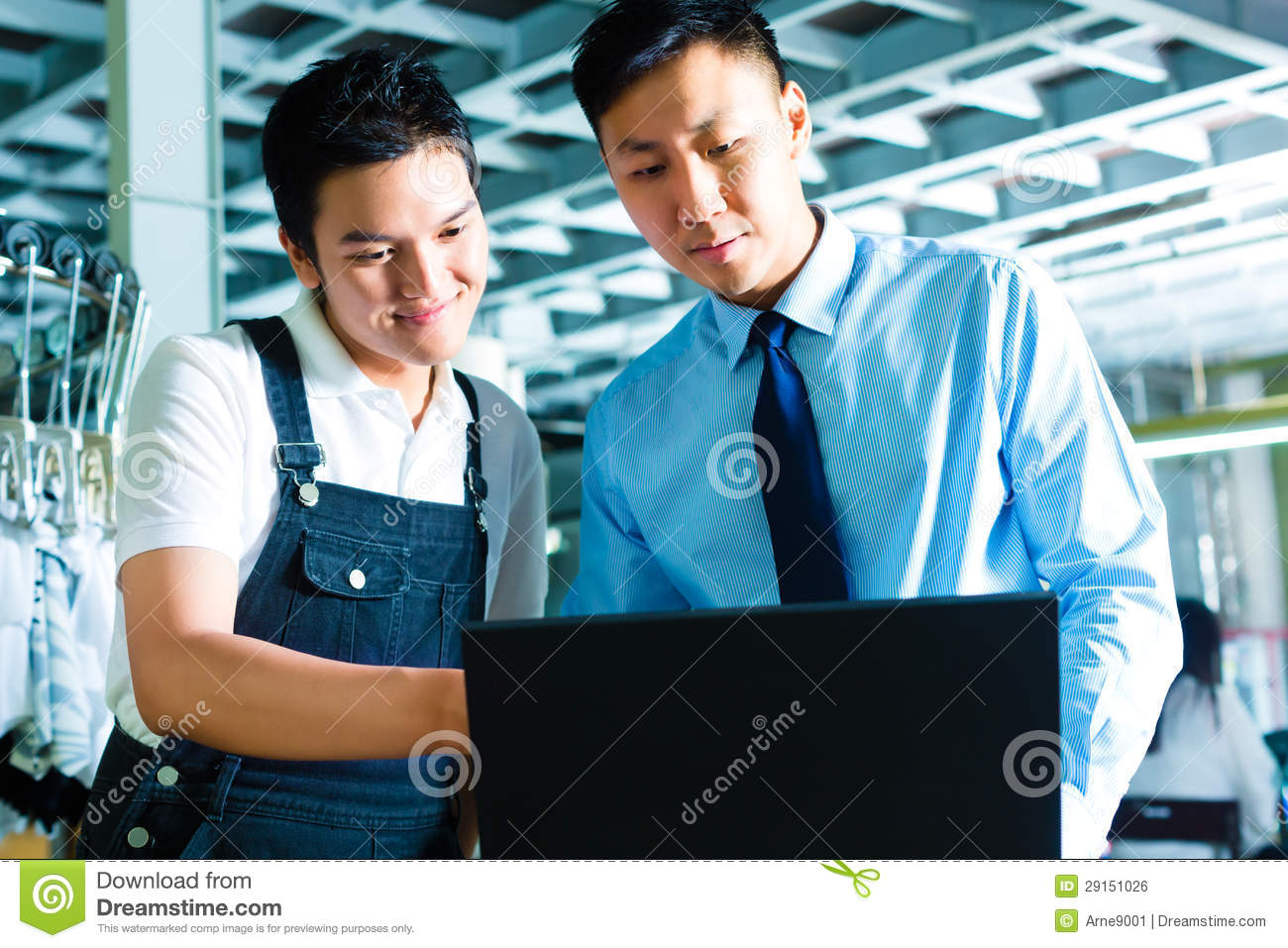 foreman manager and shift supervisor in factory royalty worker and supervisor laptop in a factory royalty stock image