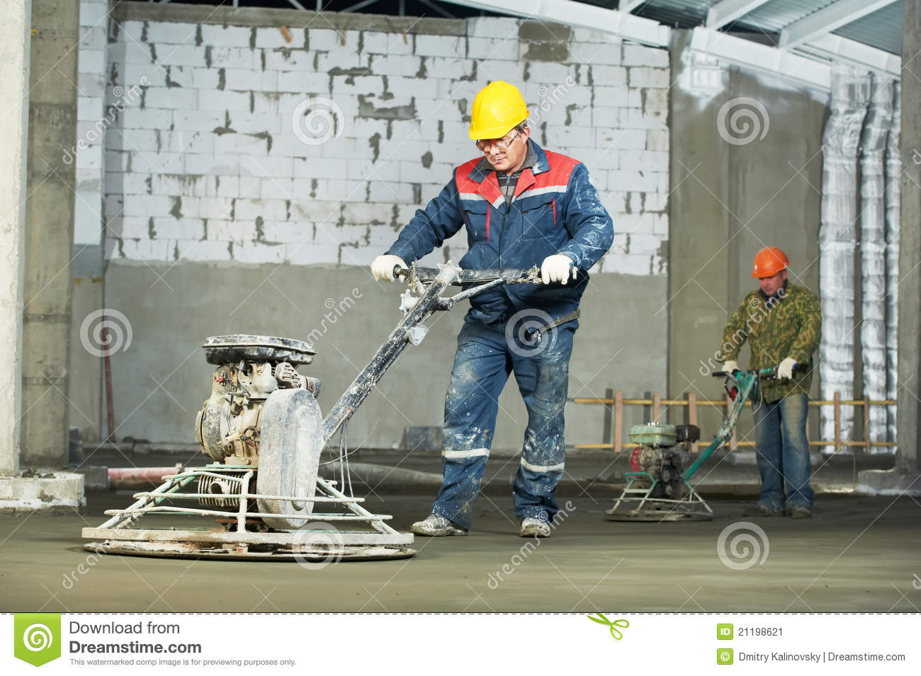 Worker trowelling and finishing of concrete