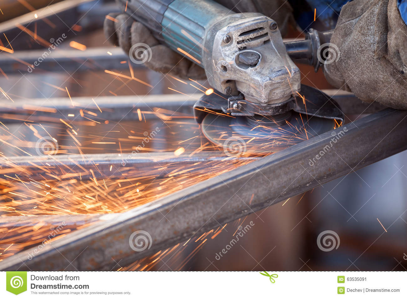 Worker using electric grinder machine cutting metal. Sparkles