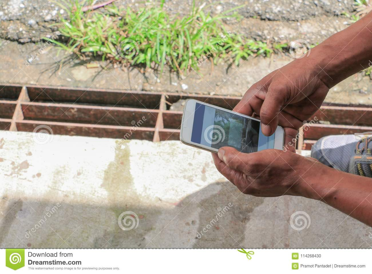 Worker using mobile smart phone