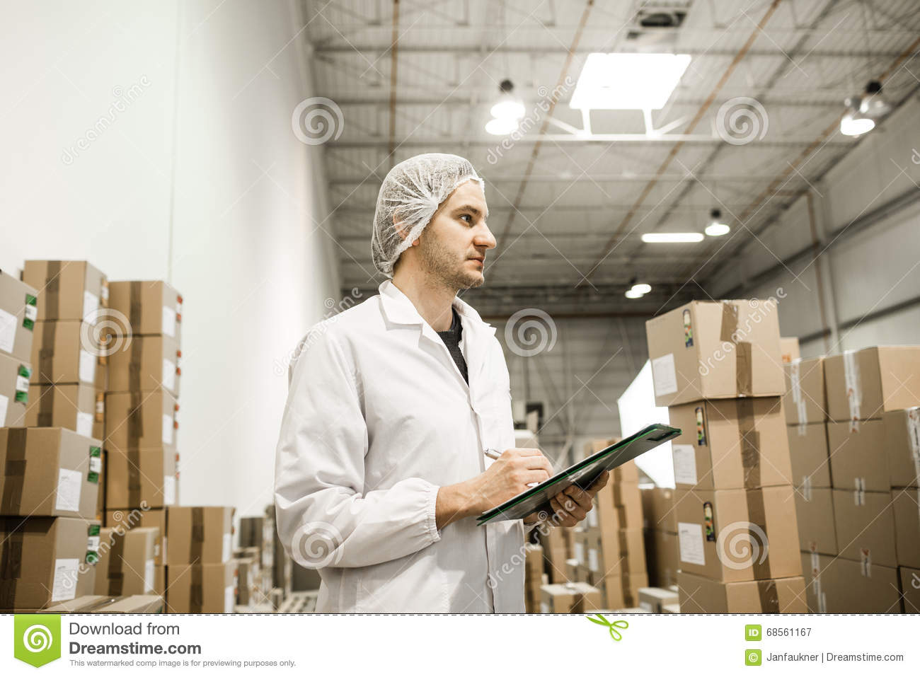 Worker In Warehouse For Food Packaging Stock Photo
