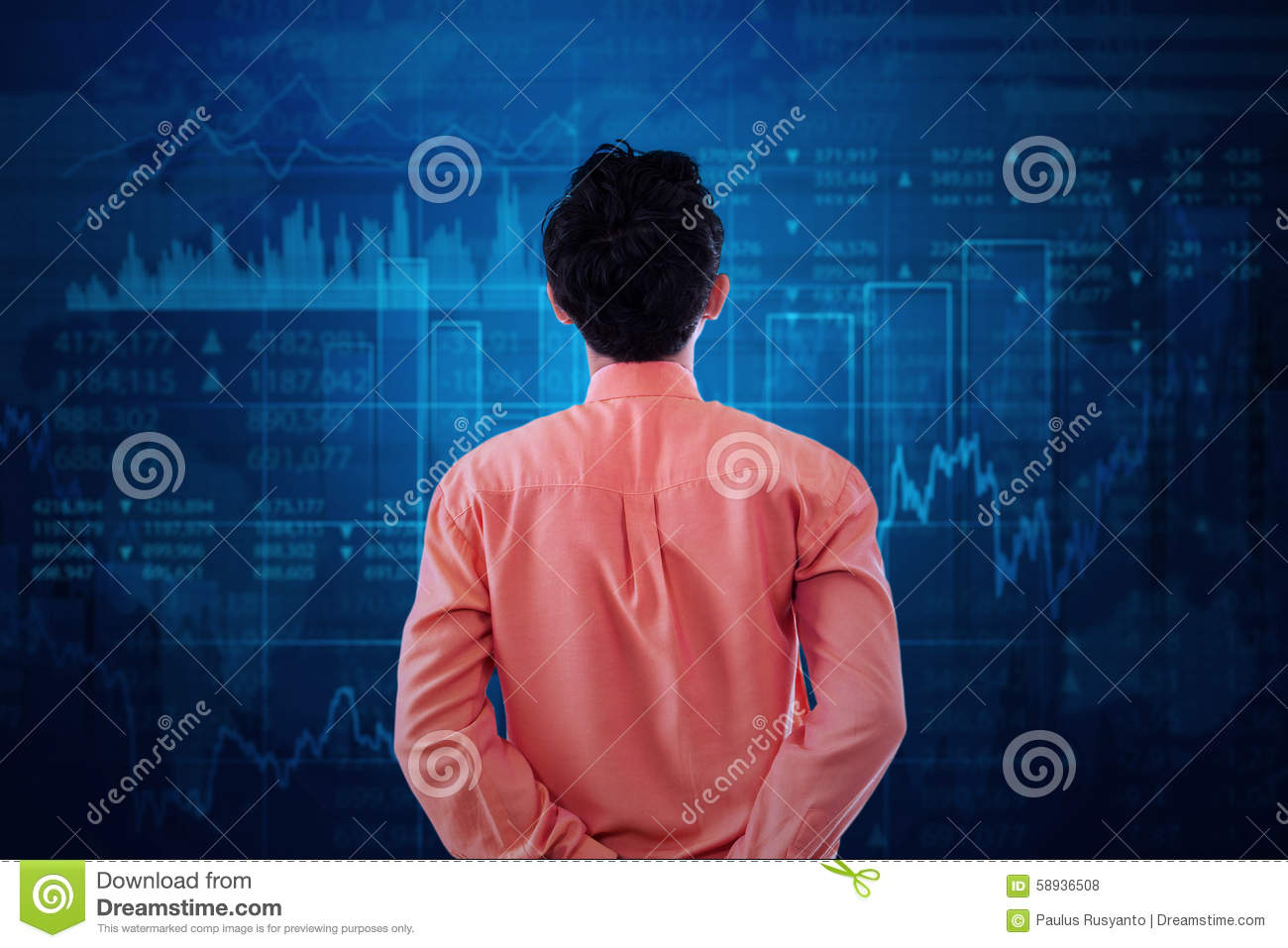 Worker watching at stock exchange graph