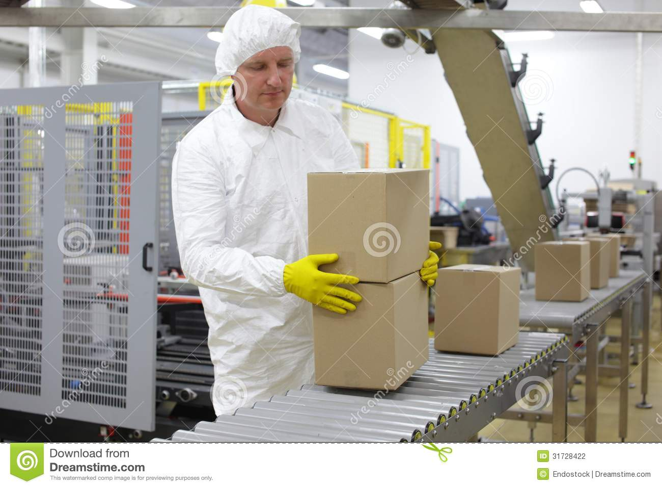 Worker Working On Packing Line In Factory Stock