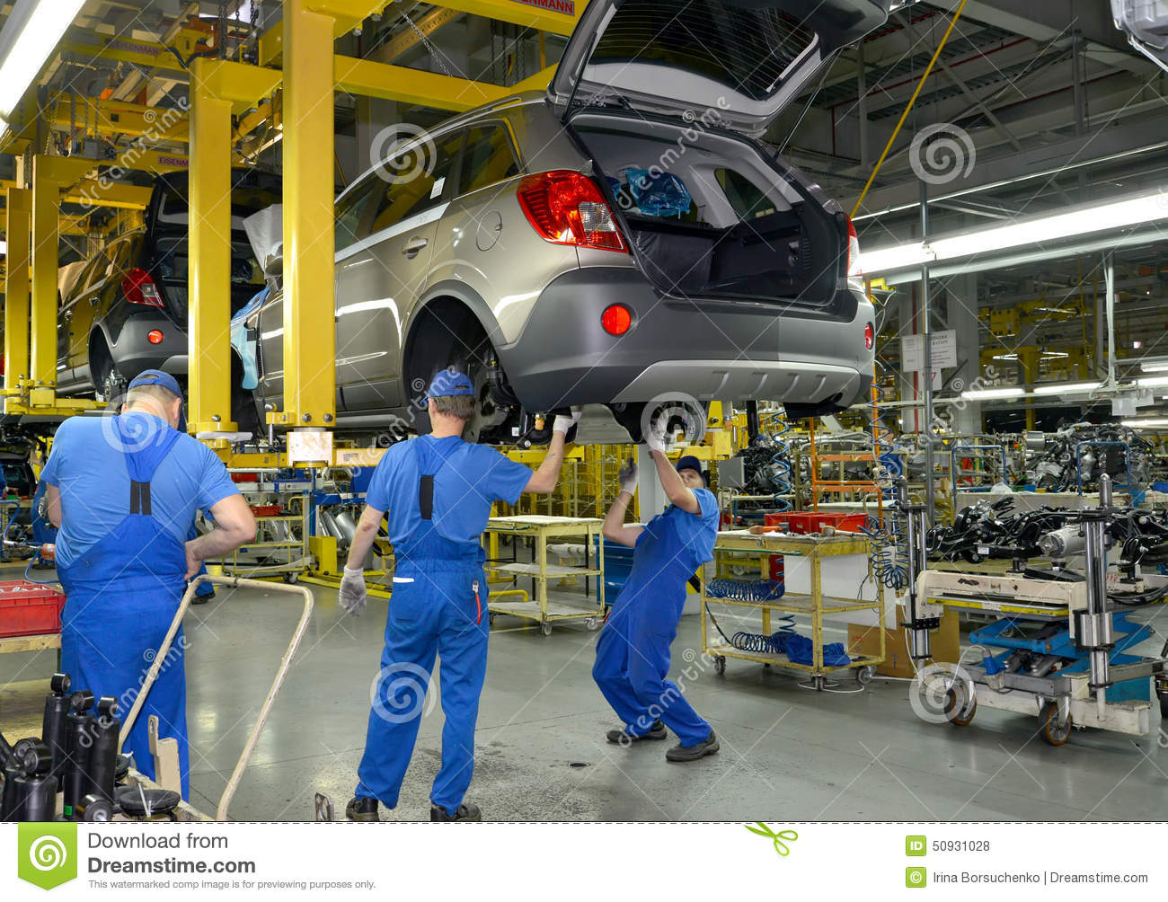 workers on the assembly conveyor of automobile plant editorial stock photo image 50931028. Black Bedroom Furniture Sets. Home Design Ideas