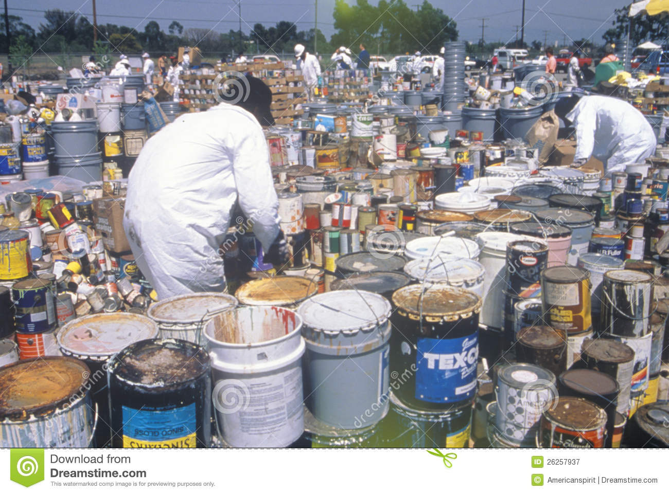 Workers handling toxic household wastes