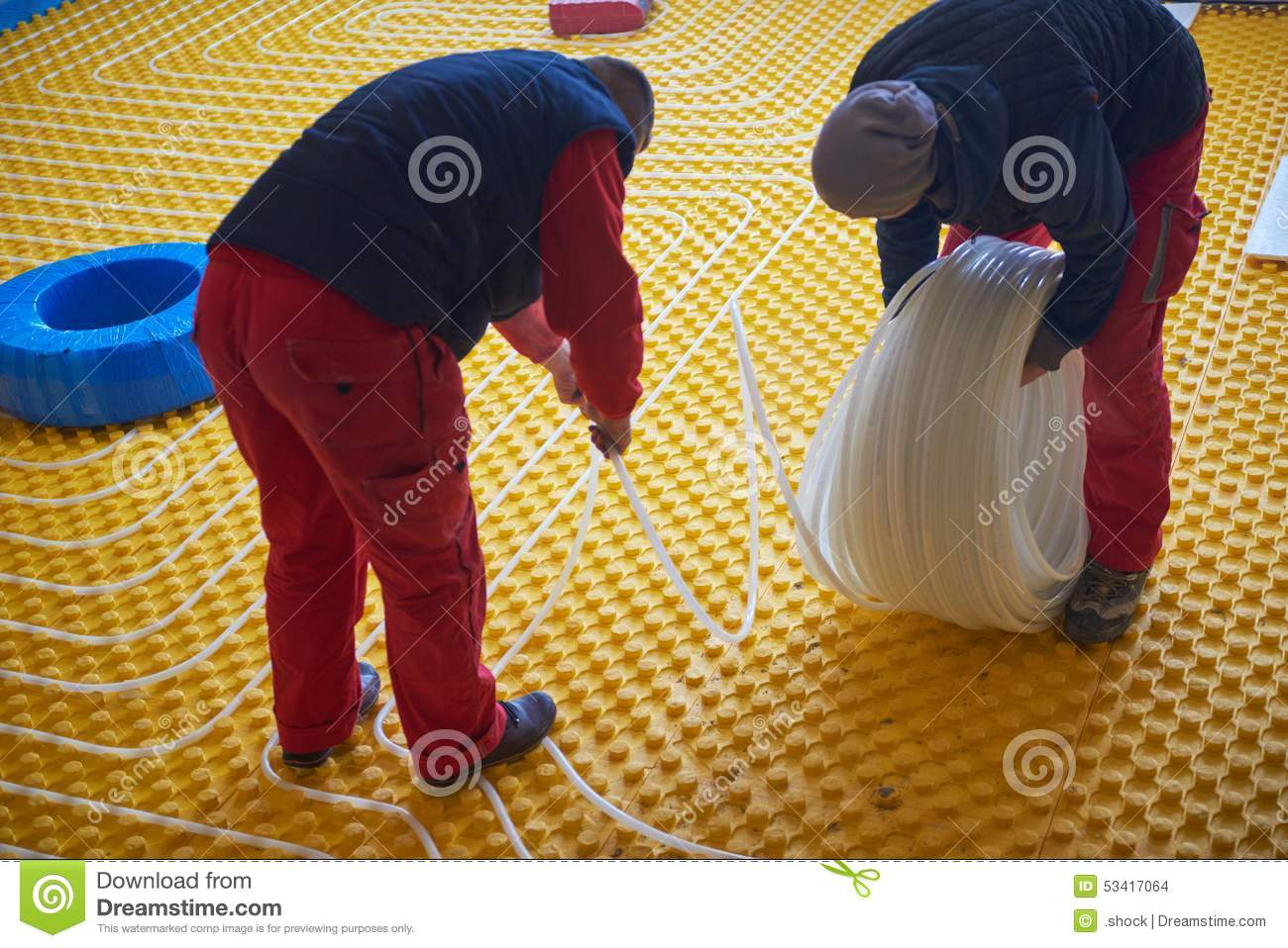 Workers installing underfloor heating system & Workers Installing Underfloor Heating System Stock Photo - Image of ...