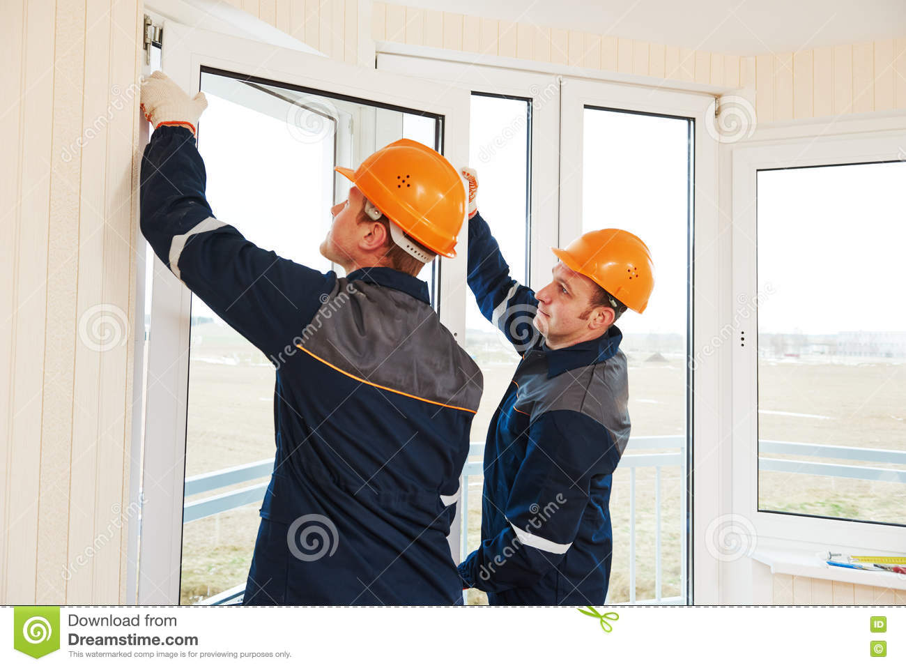 Workers installing window stock photo image 75354853 for Installation fenetre